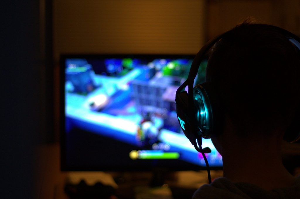 Gamer from behind blurred